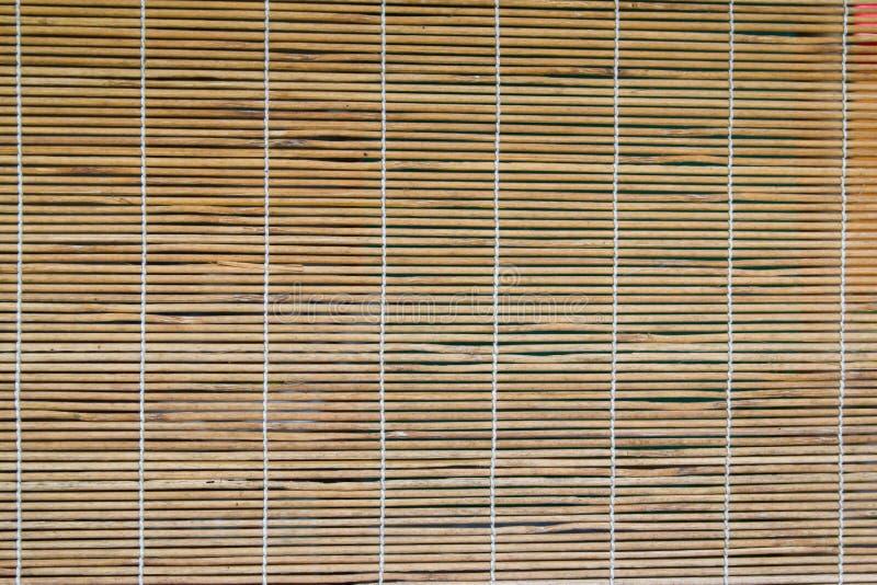 Rideau en bambou sur les hublots images libres de droits
