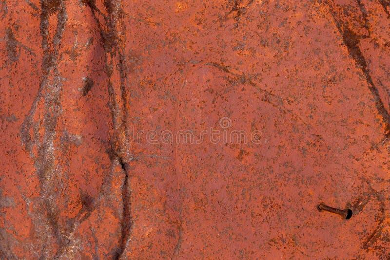 Riden ut grov brun målad metallväggtextur arkivbild