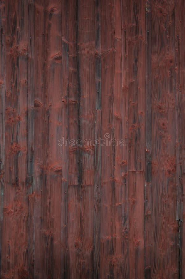 Riden ut röd målad träpanel arkivbilder