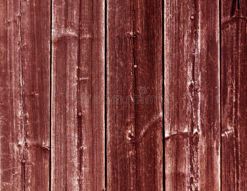 Riden ut röd trästakettextur med spikar royaltyfri bild