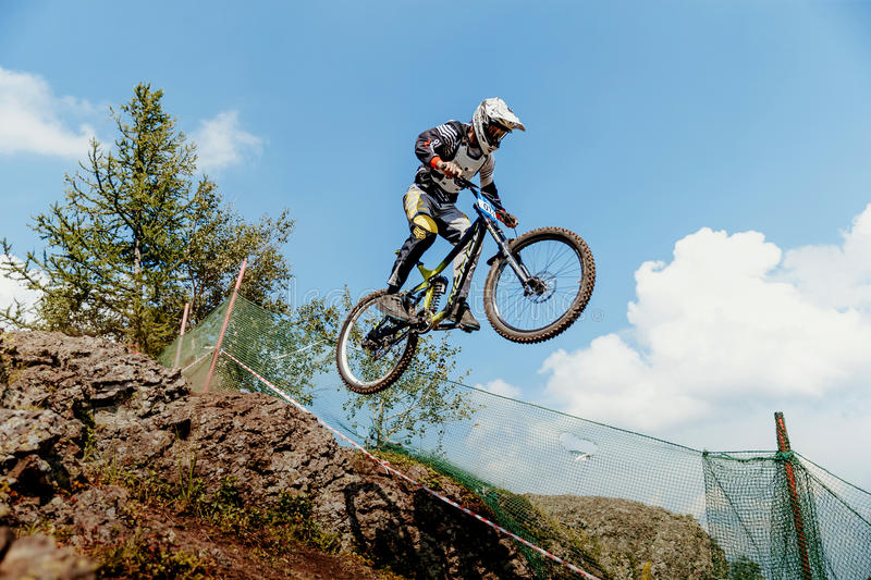 rider on bike gap jump from mountain stock images