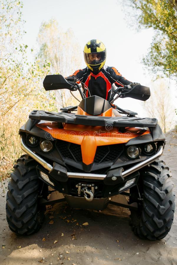Rider in helmet on quad bike, front view, closeup royalty free stock photography