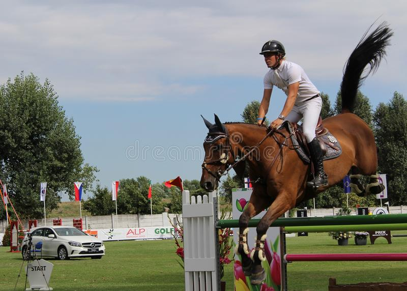 Rider on a Horse Jumping at Show Jumping Competition stock photography