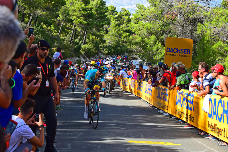 Rider Looking Around At La Vuelta España Cycle Race. A leading rider looking back near the mountain top finish in the 2017 La Vuelta Espana bike race royalty free stock photography