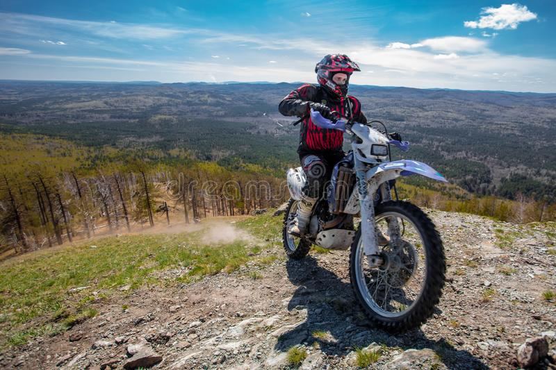 motorcycle driver in the mountains royalty free stock image