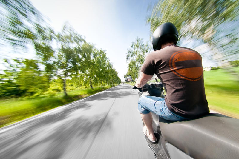 Rider on scooter motorcycle in parkway stock photos