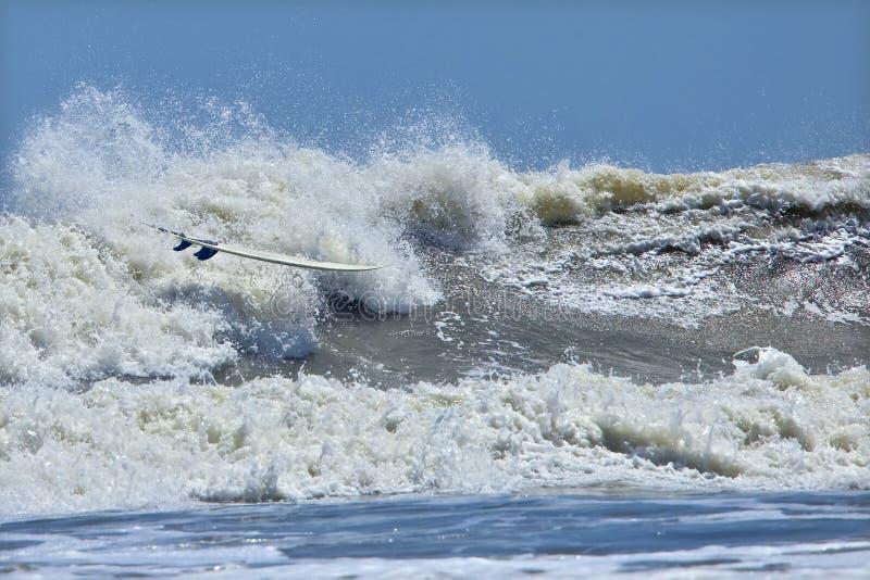 Download Riderless Surfboard In Breaker Stock Images - Image: 15963054