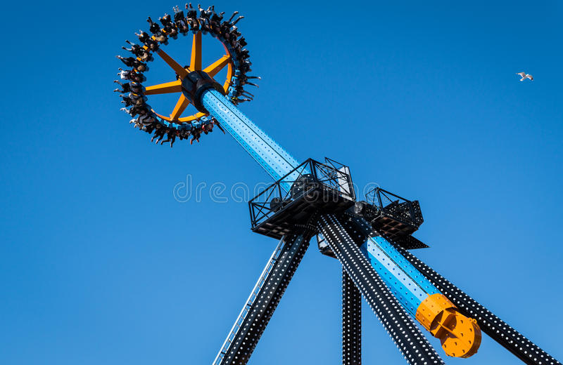 Riders at amusement park. Riders on amusement park in Sarkanniemi, Tampere, Finland stock photo
