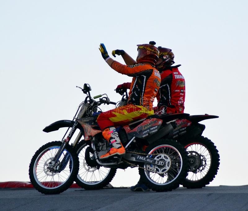 Riders. Moto motorcycle riders sport communication at the height of the show adrenaline rush stock photo
