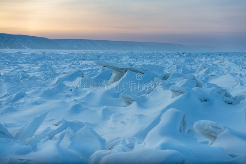 Lena Pillars at sunset on the Lena river in Republic of Sakha, Siberia. Ridged ice on the Lena river in the Natural Park Lenskie Stolby Lena Pillars, Yakutia royalty free stock images