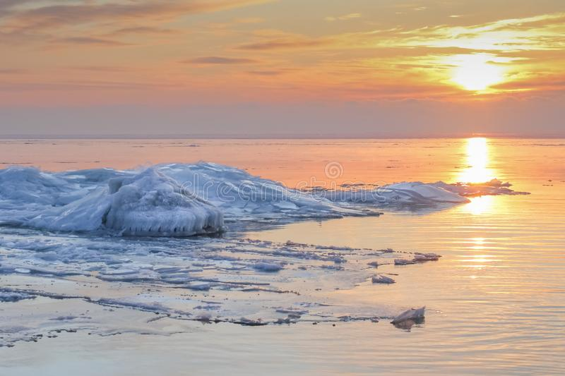 Ridges on the frozen Baltic sea in dramatic sunset in wintertime royalty free stock photo