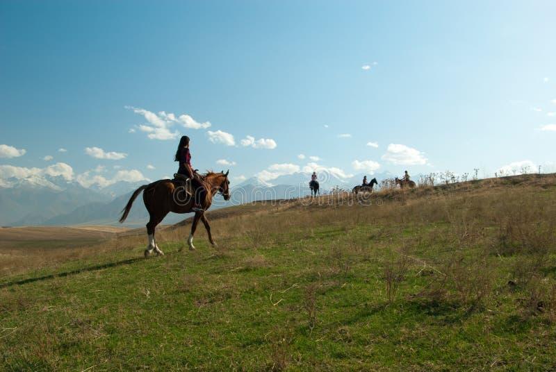 riding лошади девушки стоковая фотография