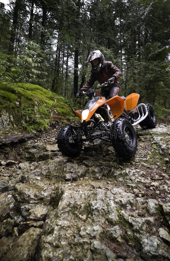 Riding ATV in mountains stock image