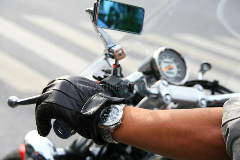 Riding a big motorbike in the city. stock images
