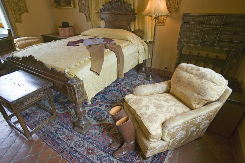 Riding boots and outfit displayed in guest room of Hearst Castle, San Simeon, California stock images