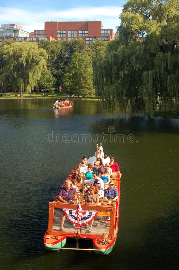 Riding on Boston`s famed swan boats royalty free stock photo