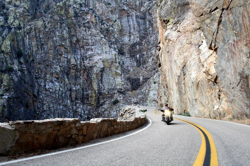 Motorcycle riding in kings canyon. Riding through canyon in kings canyon national park stock image