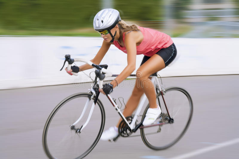 Riding fast bike outdoors royalty free stock image