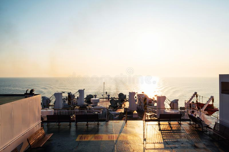 Riding a ferry from Osaka to Beppu, Japan at sunrise. Rising sun. Beppu, Japan. Riding a ferry from Osaka to Beppu, Japan at sunrise. Rising sun, horizon over stock photography