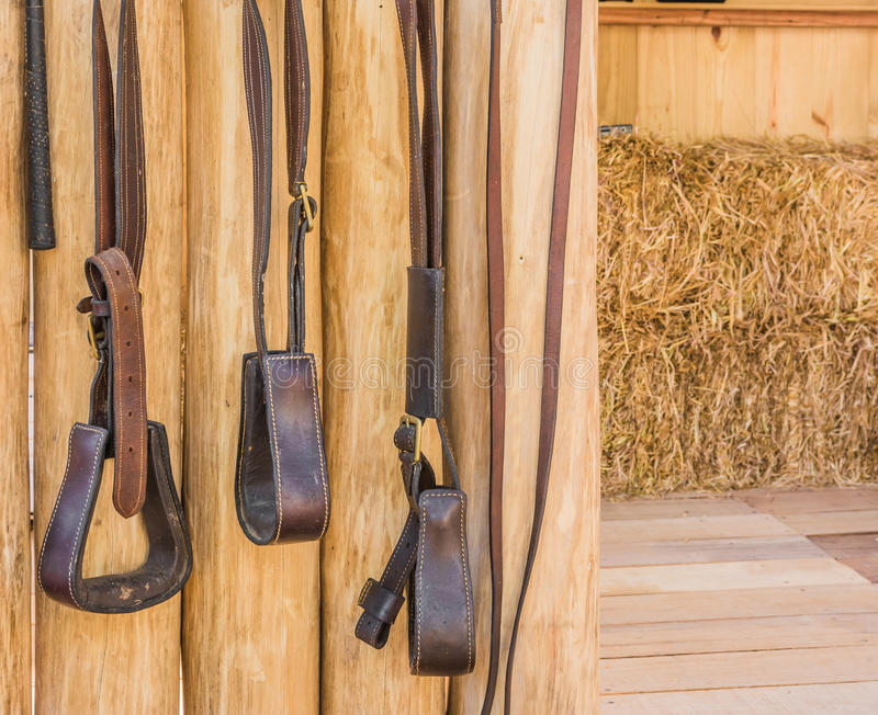 Riding horse equipment. Hang on wooden fence royalty free stock images