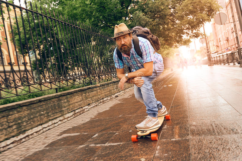 Riding on longboard in the streets urban, setting of lifestyle concept. Man riding on longboard in the streets urban, setting of lifestyle concept stock photo