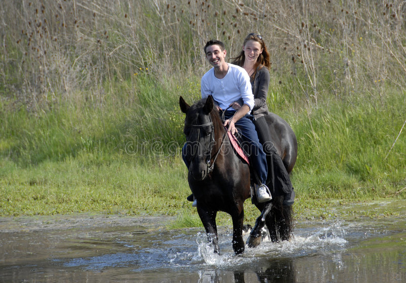 Riding lovers stock image