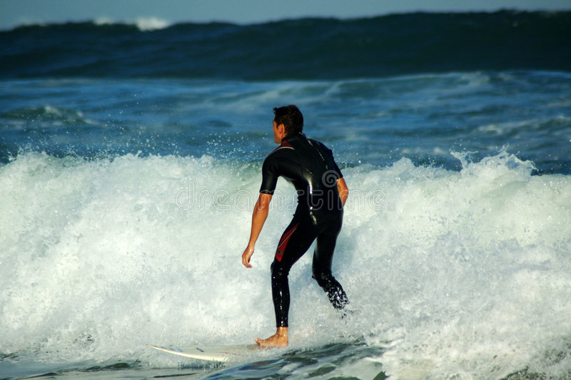 Download Riding out the wave stock photo. Image of surfing, beach - 351240