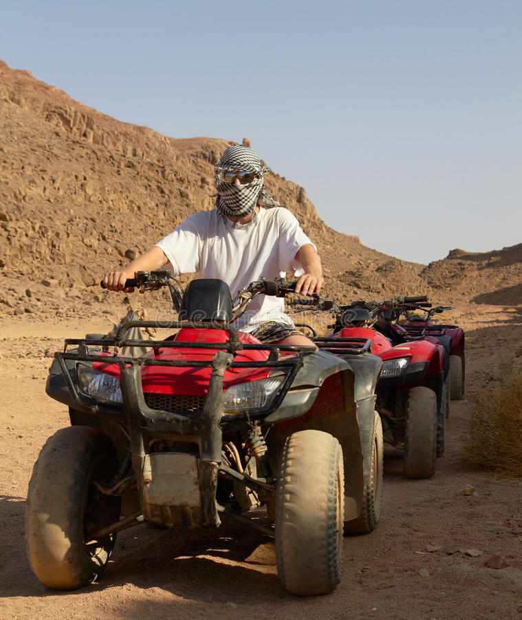 Free Riding Quad Bikes In Desert Royalty Free Stock Photos - 24278578