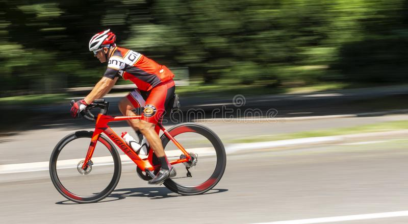 Riding road racing bike downhill in central park stock photos