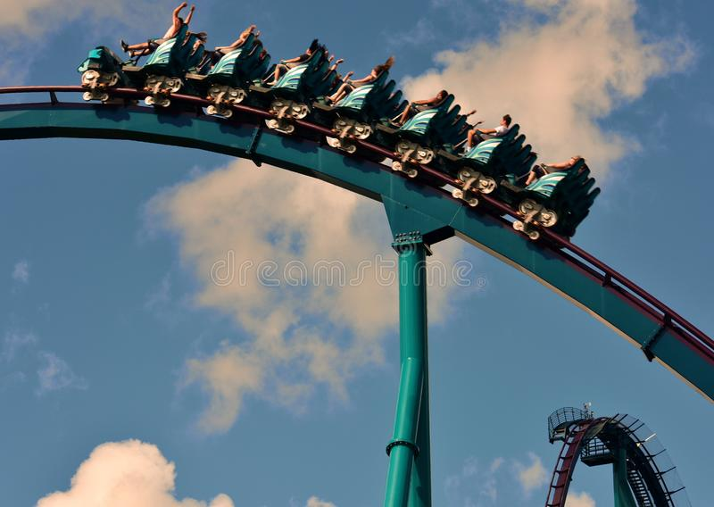 Riding roller coaster at amusement park. royalty free stock photography