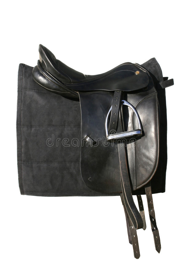 Riding Saddle. Isolated black riding saddle and saddle pad royalty free stock photos