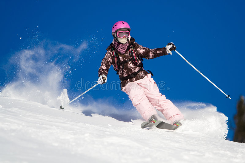 Riding on skis royalty free stock image