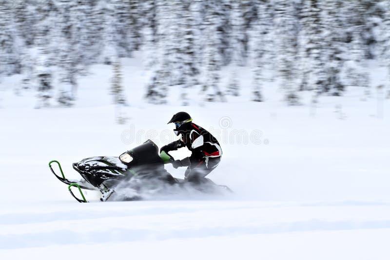 Riding snowmobile stock photos