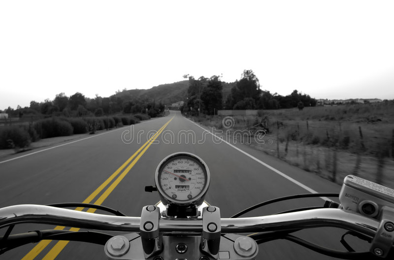 Riding a straight road royalty free stock photography