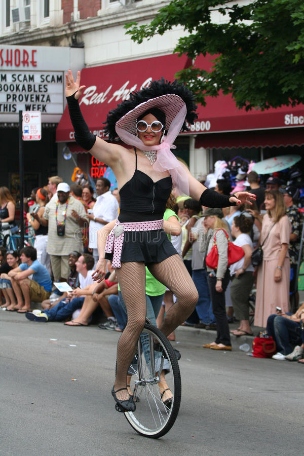 riding Unicycle show for Chicago Gay Parade stock image
