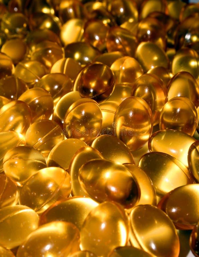 Ridurre in pani dell'olio di fegato di merluzzo immagini stock