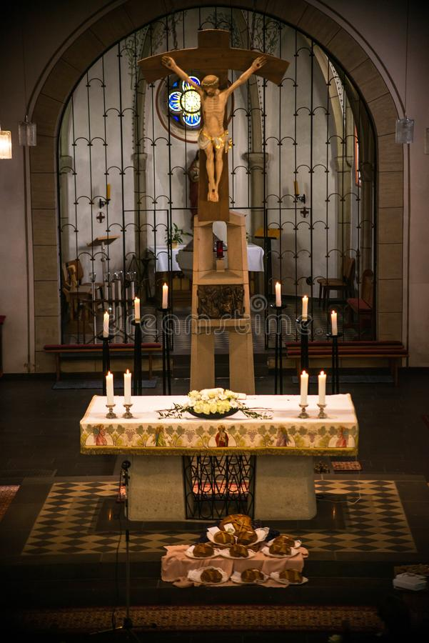 Rieden Germany 15.04.2018 Altar Setup with jesus Christ on the Cross hang behind the altar of the local church of Rieden royalty free stock images