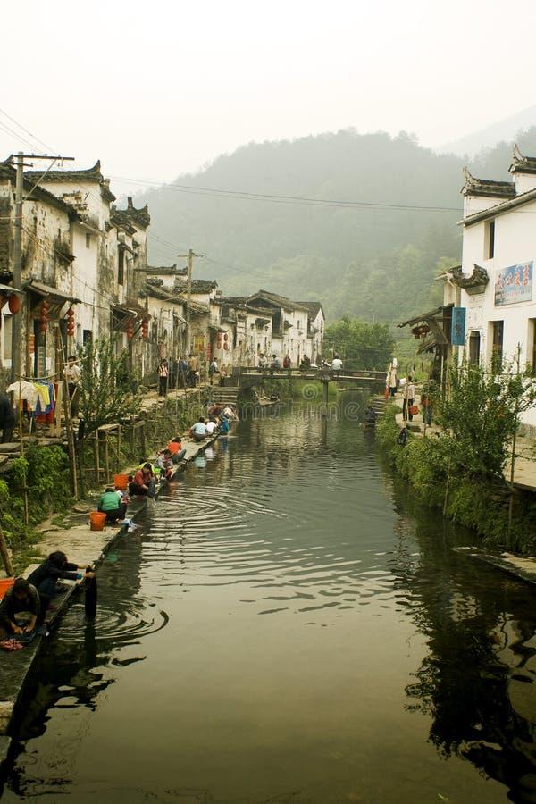 Riegue la aldea Likeng en el sur de China, vida de cada día foto de archivo