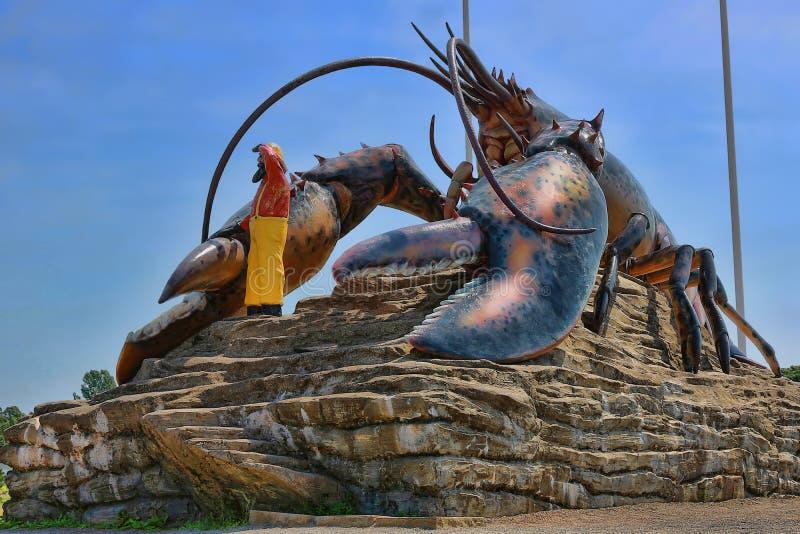 Riesiger Hummer-Statuen-Markstein stockbilder