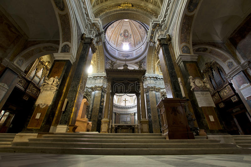RIeti Cathedral Lazio, Italy. RIETI, ITALY - APRIL 16, 2016: Baroque altar under the canopy in the Santa Maria Assunta Cathedral royalty free stock images