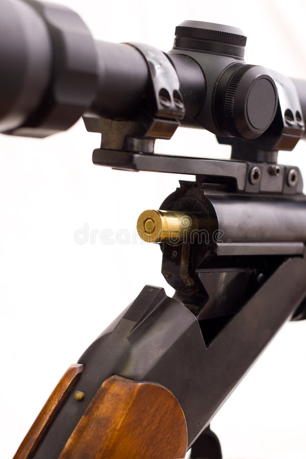 Rifle. A part of an open rifle, whit a bullet in it stock photos
