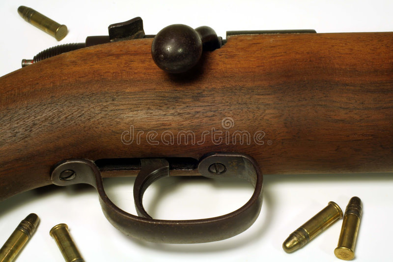 Rifle & Bullets. This is a close up image of a rifle and bullets stock images