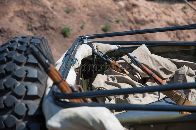Rifle and a military machine during the Second World War. Reconstruction of hostilities 2018-04-30 Samara Region, Russia stock photos