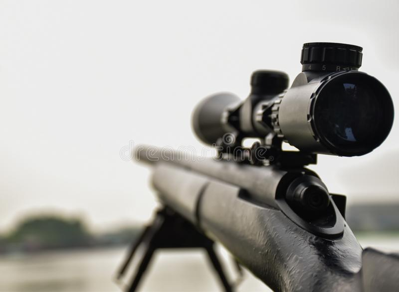Rifle with a scope and bipod royalty free stock images