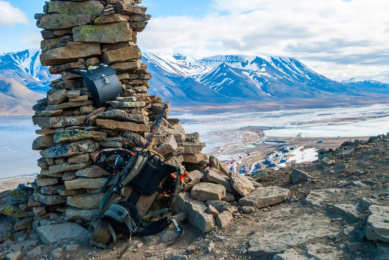 Rifle and snow shoes overlooking Longyearbyen city, Svalbard stock photography