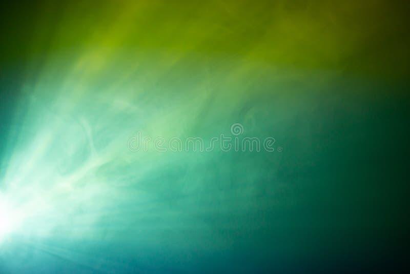 Riflettore verde del fumo fotografia stock