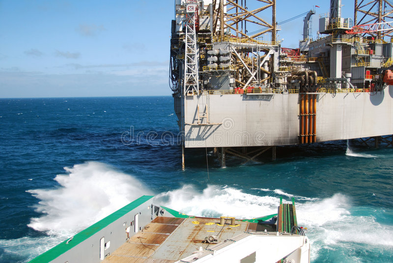 Rig move of an Jack-up rig stock images