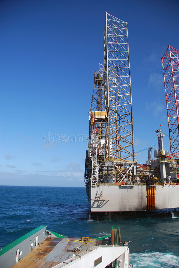 Rig move of an Jack-up rig royalty free stock photography