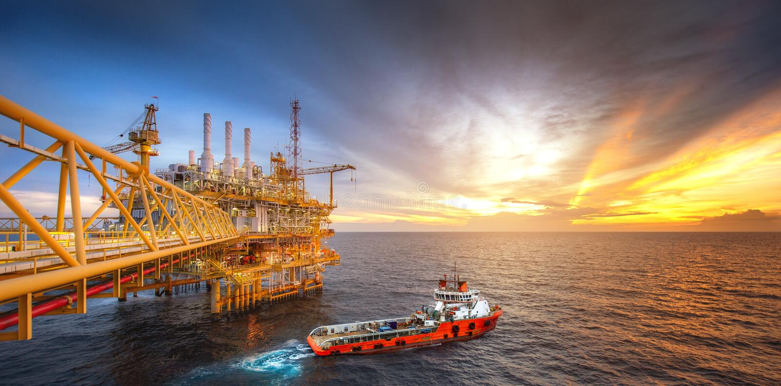 Rig platform and Supply vessel in the gulf stock photos