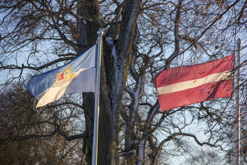 Riga and latvia flag in winter royalty free stock photo